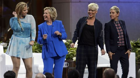 Actress Amy Schumer, left, Democratic presidential candidate Hillary Rodham Clinton, musician Pink, and  Ellen DeGeneres  dance on stage during a taping of The Ellen DeGeneres Show, Tuesday, Sept. 8, 2015, at Rockefeller Center in New York.