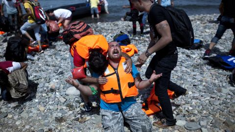A refugee from Syria prays after arriving on the shores of the Greek island of Lesbos aboard an inflatable dinghy across the Aegean Sea from from Turkey on September 7, 2015. Greece sent troops and police reinforcements on September 6 to Lesbos after renewed clashes between police and migrants, the public broadcaster said, while Syrian refugees on the island were targeted with Molotov cocktail attacks. More than 230,000 people have landed on Greek shores this year and the numbers have soared in recent weeks as people seek to take advantage of the calm summer weather. AFP PHOTO / ANGELOS TZORTZINIS        (Photo credit should read ANGELOS TZORTZINIS/AFP/Getty Images)