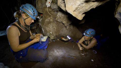 """Underground astronauts"" Marina Elliott and Becca Peixotto work inside the cave where fossils of Homo naledi were discovered."