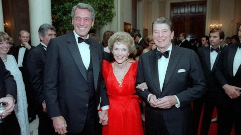 """One-time Hollywood colleagues, President Ronald Reagan and first lady Nancy Reagan invited Hudson to a White House state dinner in May 1984. Hudson found out he had AIDS a month later, a diagnosis he kept secret from all but a few friends for more than a year. <a href=""""http://articles.latimes.com/1985-09-20/news/mn-6330_1_aids-project"""" target=""""_blank"""" target=""""_blank"""">Ronald Reagan, who called Hudson while he was hospitalized, didn't refer to AIDS publicly</a> until shortly before the star's death in 1985; he didn't give <a href=""""http://www.nytimes.com/1987/06/01/us/reagan-urges-wide-aids-testing-but-does-not-call-for-compulsion.html"""" target=""""_blank"""" target=""""_blank"""">a formal speech on the health crisis until May 1987</a>."""