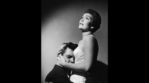 """""""Magnificent Obsession"""" (1954) offered Hudson a star-making part opposite Jane Wyman after more than 20 films while under contract to Universal Pictures. He played a reckless playboy whose selfish ways contribute to the death of Wyman's husband and then to her blindness before he eventually redeems himself as a surgeon who heals her. Female moviegoers swooned at the new matinee idol in this improbable romantic melodrama directed by Douglas Sirk."""