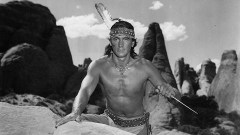 """Shortly before becoming a major star, Hudson made a less than convincing Native American in """"Taza, Son of Cochise"""" (1954), donning a black wig and wearing dark makeup. The brazen miscasting in this Western was typical of many of his early mediocre movies, which relied heavily on his strapping 6-foot-4 physique. Shirtless photos of Hudson dominated fan magazines in the early '50s -- so much so that he became known as """"<a href=""""http://www.washingtonpost.com/archive/lifestyle/1977/07/20/the-baron-of-beefcake-at-50/44cdf29e-f5b1-46eb-b717-7e95c7e9f287/"""" target=""""_blank"""" target=""""_blank"""">the Baron of Beefcake</a>."""""""