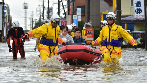 Rescue workers transport evacuees through the streets of Oyama on September 10.