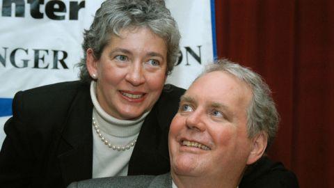 Lucinda Marker wraps her arm around her husband, John Tull, at Beth Israel Hospital in New York in February 2004.