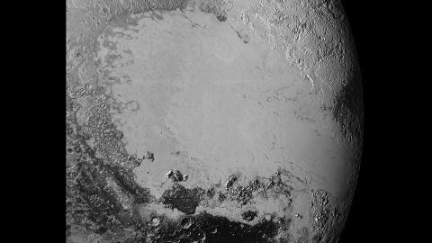 Scientists say that what looks like mountains could be huge blocks of frozen water suspended in frozen nitrogen. On the new photos, taken on July 14 and released on September 10, a pixel is 400 meters (440 yards). New Horizons' closest pass by Pluto took it about 50,000 miles from the surface.