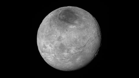 Just before its closest approach to Pluto on July 14, NASA's New Horizons spacecraft snapped this photo of Charon, Pluto's largest moon. The photo was shot at a distance of 290,000 miles away. Charon's north pole region is markedly dark. This photo was released on September 10.