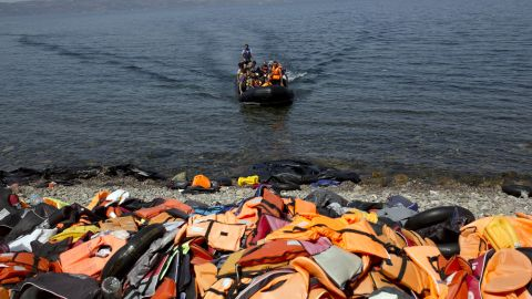 Discarded life jackets line the rocky shores of Lesbos, Greece on September 10, 2015. The remnants of inflatable boats also litter the beach. Migrants are advised to slash their rafts when they arrive so that authorities can't push them back to sea.