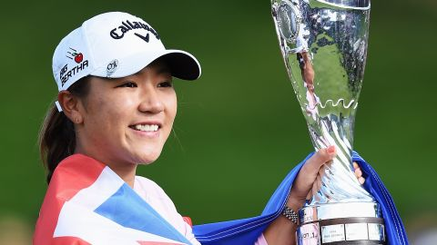 Lydia Ko of New Zealand holds the trophy aloft after winning the Evian Championship in France.