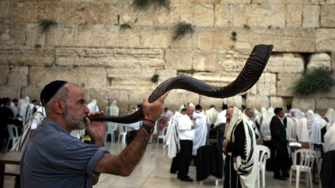 """Rosh Hashanah means """"head of the year"""" in Hebrew. It is a time for reflection and repentance and is referred to as the """"day of judgment"""" or the """"day of repentance."""" One of the most significant rituals of the holiday is the blowing of the shofar, or ram's horn. It is used as a call to repentance during the High Holy Days."""