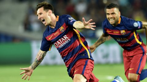 Messi vs Sevilla  Barcelona's Argentinian forward Lionel Messi (L) celebrates scoring a goal during the UEFA Super Cup final football match between FC Barcelona and Sevilla FC in Tbilisi on August 11, 2015. AFP PHOTO/KIRILL KUDRYAVTSEV        (Photo credit should read KIRILL KUDRYAVTSEV/AFP/Getty Images)