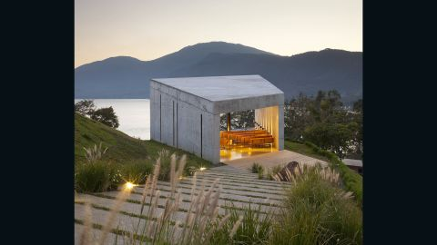 """""""It was intended as a scene for the landscape and handled as a unique space developed with a single material --  concrete -- to highlight the lake and mountains,"""" says Gabriela Siman, project manager at EMC Arquitectura. The design's informal reticular pattern deliberately limits the visitor's view to the lake, enticing you to explore its greater surroundings."""