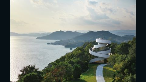 """Hiroshi Nakamura, CEO of Hiroshi Nakamura & NAP Co. Ltd, says the chapel's form-defying design symbolizes the union of marriage: """"Just as two lives go through twists and turns before uniting as one, the two spirals seamlessly connect at the top to form a single ribbon. By entwining two spiral stairways, we realized a free-standing building of unprecedented composition could architecturally embody the act of marriage. At this chapel, bride and groom ascend the stairs separately to be joined together at the top, ask for heaven's pardon, and declare their marriage."""""""