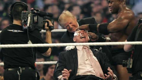 DETROIT - APRIL 1: WWE chairman Vince McMahon (C) has his head shaved by Donald Trump (L) and Bobby Lashley (R) after losing a bet in the Battle of the Billionaires at the 2007 World Wrestling Entertainment's Wrestlemania at Ford Field on April 1, 2007 in Detroit, Michigan. Umaga was representing McMahon in the match when he lost to Bobby Lashley who was representing Trump. (Photo by Bill Pugliano/Getty Images)