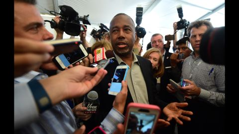 Carson answers reporters' questions before the debate.