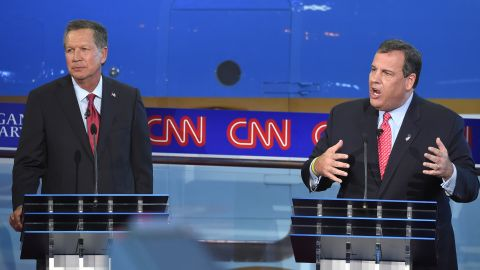 Christie delivers an answer as Kasich looks on.