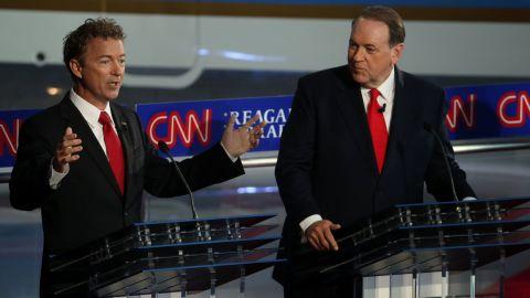 Paul and Huckabee participate in the debate.