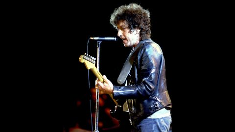 Bob Dylan performs at a  Farm Aid concert in 1985.
