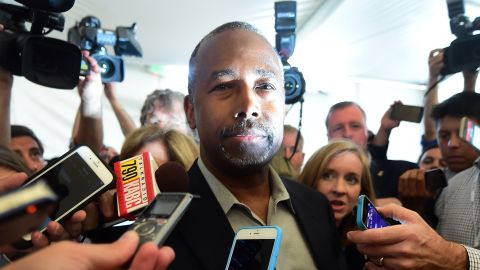 Republican Presidential candidate Ben Carson responds to questions from reporters upon entry to the press room at the Ronald Reagan Presidential Library in Simi Valley, California on September 16, 2015.