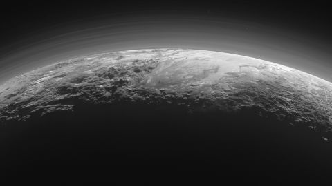 This image of the surface of Pluto was taken just 15 minutes after NASA's New Horizon spacecraft made its closest approach to the icy planet on July 14. As it looked toward the Sun, the spacecraft's camera captured more than dozen thin layers of haze in Pluto's atmosphere, at least 60 miles (100 kilometers) above the surface. The photo was downlinked to Earth on September 13.