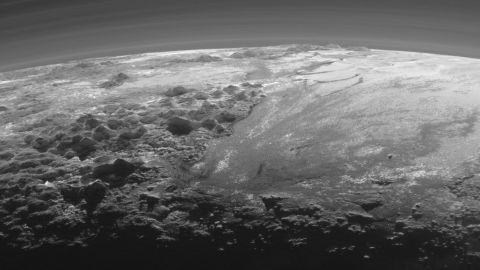 """This image of Pluto's icy and mountainous landscapes was taken from a distance of 11,000 miles (17,700 kilometers). """"This image really makes you feel you are there, at Pluto, surveying the landscape for yourself,"""" said New Horizons Principal Investigator Alan Stern of the Southwest Research Institute in Colorado."""