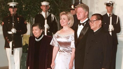 U.S. President Bill Clinton and First Lady Hillary Clinton welcome former Chinese President Jiang Zemin and his wife Wang Yeping at a White House state dinner in Jiang's honor on October 29, 1997. During his visit to the U.S., Putting aside their differences on human rights and democratic reform, Clinton and Jiang announced a pact aimed at halting the spread of nuclear weapons and giving China access to U.S. nuclear power plant technology.
