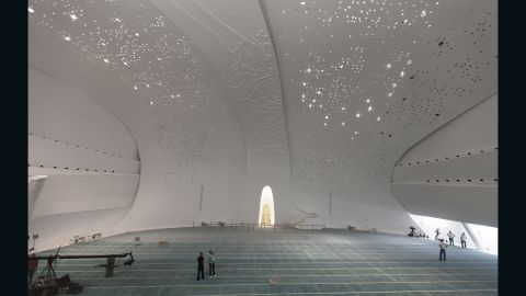 According to Mangera Yvars Architects, the design incorporates the ethereal qualities of Islamic space --the use of light, the reverberation of prayer, the use of calligraphy, geometry and ornamentation. Calligraphy and Qur'anic verse decorates the building's facade. The design of the building's acoustics enable the call to prayer to resonate throughout the building.