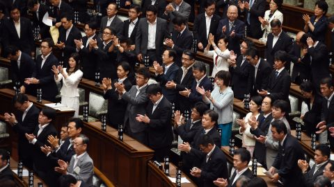 Councillors of the upper house applaud after the security bill passed the parliament on early September 19, 2015. The bill would allow troops to fight on foreign soil for the first time since World War II, despite fierce criticism it will fundamentally alter the character of the pacifist nation.        AFP PHOTO / TOSHIFUMI KITAMURA        (Photo credit should read TOSHIFUMI KITAMURA/AFP/Getty Images)