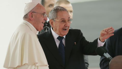 Pope Francis speaks with Cuba's President Raul Castro during his arrival ceremony at the airport in Havana, Cuba, Saturday, Sept. 19, 2015. Pope Francis begins a 10-day trip to Cuba and the United States on Saturday, embarking on his first trip to the onetime Cold War foes after helping to nudge forward their historic rapprochement. (AP Photo/Ramon Espinosa)