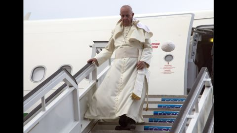 Pope Francis' cap flies off his head as he deplanes in Havana, Cuba, Saturday, Sept. 19, 2015. The pope began his 10-day trip to Cuba and the United States, embarking on his first trip to the onetime Cold War foes after helping to nudge forward their historic rapprochement. (AP Photo/Ismael Francisco, Cubadebate Via AP)