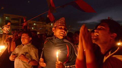 In this photograph taken on September 17, 2015, Nepalese activists hold lighted candles as they celebrate the country's new national constitution in Kathmandu.