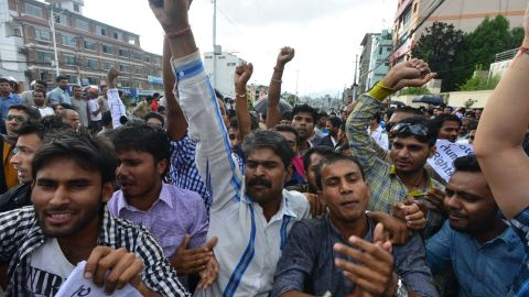 Nepalese activists of the Madhesi group chant slogans against the proposed constitution at near parliament in Kathmandu on September 19, 2015. The new constitution, endorsed in parliament, is the first to be drawn up by elected representatives of Nepal's people after centuries of autocratic rule. It is the final stage in a peace process that began when the Maoists laid down their arms in 2006 after a decade-long civil war with state forces and turned to politics, winning parliamentary elections two years later and abolishing the monarchy.
