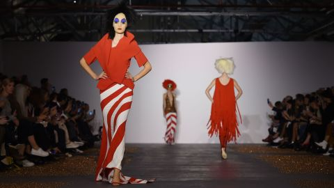 """At Gareth Pugh, models faces were covered in gauze, which was then painted with makeup. The final effect was somewhere between a clown and drag star <a href=""""http://divineofficial.com/"""" target=""""_blank"""" target=""""_blank"""">Divine</a>."""