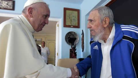 Pope Francis and Cuba's Fidel Castro shake hands, in Havana, Cuba, Sunday, Sept. 20, 2015. The Vatican described the 40-minute meeting at Castro's residence as informal and familial, with an exchange of books. (AP Photo/Alex Castro)