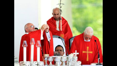 Pope Francis, left, blesses the communion bread during the Holguin Mass on September 21.