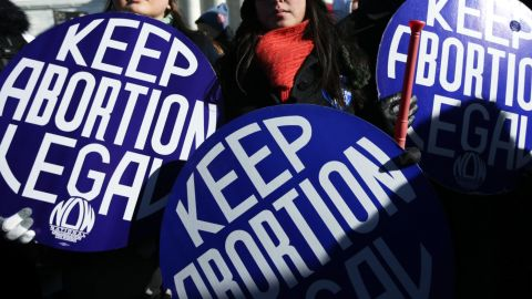 WASHINGTON, DC - JANUARY 22:  Pro-choice activists hold signs as marchers of the annual March for Life arrive in front of the U.S. Supreme Court January 22, 2014 on Capitol Hill in Washington, DC. Pro-life activists from all around the country gathered in Washington for the event to protest the Roe v. Wade Supreme Court decision in 1973 that helped to legalize abortion in the United States.  (Photo by Alex Wong/Getty Images)