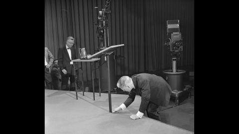 CBS President Frank Stanton fixes the debate stage.