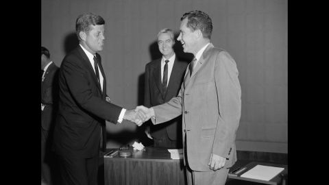 The candidates shake hands as moderator Howard K. Smith looks on. The one-hour debate took place in Chicago at the studios of CBS affiliate WBBM.