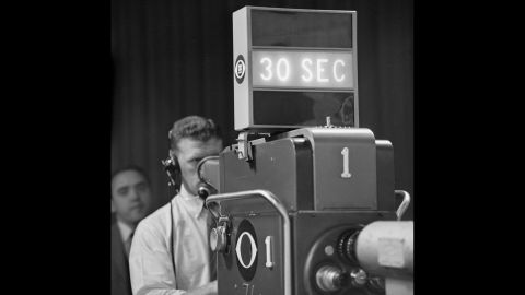 A CBS camera flashes a 30-second warning to those on stage.