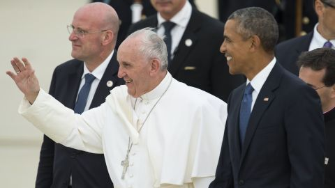 Pope Francis waves alongside US President Barack Obama upon arrival at Andrews Air Force Base in Maryland, September 22, 2015, on the start of a 3-day trip to Washington. AFP PHOTO / SAUL LOEB        (Photo credit should read SAUL LOEB/AFP/Getty Images)