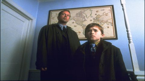 """Director/writer M. Night Shyamalan is fond of twists and probably put them to best use in his first major film, 1999's """"The Sixth Sense."""" Psychologist Malcolm Crowe (Bruce Willis) hears Cole Sear (Haley Joel Osment) say he can see dead people, but Crowe doesn't realize that he's one of them -- until trying to talk to his wife near the end."""