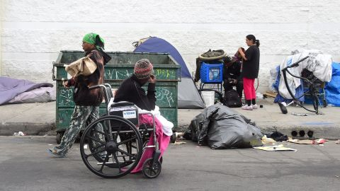 Homeless women prepare for another day and night on the street near Skid Row in Los Angeles, California on May 12, 2015. A report released by the Los Angeles Homeless Authority on May 11 showed a 12% increase in the homeless population in both Los Angeles city and county, which according to the report have been driven by soaring rents, low wages and stubbornly high unemployment. One of the most striking findings from the biennial figures released saw the number of makeshift encampments, tents and vehicles occupied by the homeless increased 85%.  AFP PHOTO / FREDERIC J. BROWN        (Photo credit should read FREDERIC J. BROWN/AFP/Getty Images)