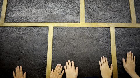 """Muslim pilgrims touch Islam's holiest shrine, the <a href=""""https://www.khanacademy.org/humanities/art-islam/beginners-guide-islamic/a/the-kaaba"""" target=""""_blank"""" target=""""_blank"""">Kaaba</a>, at the Grand Mosque in Mecca on Monday, September 21. Performing the Hajj is one of the five pillars of Islam."""