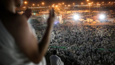 Muslim pilgrims pray on the Mountain of Mercy, on the plain of Arafat. Islam requires every Muslim who is physically and financially able to make the journey to Mecca at least once in his or her lifetime.