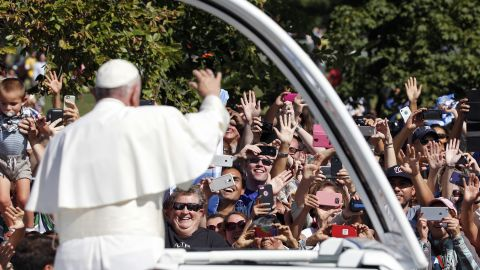 Pope Francis greets crowds during his parade in Washington on September 23.