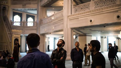 People explore the new mosque.