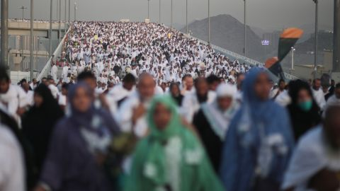 """Hundreds of thousands of Muslim pilgrims make their way to cast stones at a pillar symbolizing the stoning of Satan, in a ritual called """"Jamarat,"""" the last rite of the annual hajj, on the first day of Eid al-Adha, in Mina near the holy city of Mecca, Saudi Arabia, Thursday, Sept. 24, 2015. (AP Photo/Mosa'ab Elshamy)"""