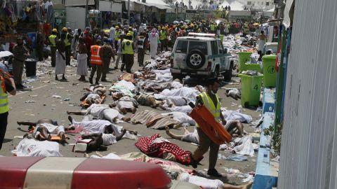 Bodies lie in the street as emergency personnel work.