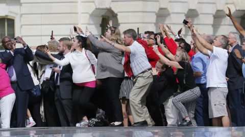 Congressional staffers and guests strain to view and photograph the Pope at the Capitol.