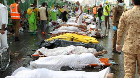 """Saudi emergency personnel surround bodies of Hajj pilgrims at the site of a stampede Thursday, September 24, in Mecca, Islam's holiest city. Thursday morning's stampede killed hundreds during one of the last rituals of the<a href=""""http://www.cnn.com/2015/09/23/world/gallery/hajj/index.html""""> Hajj, the annual Islamic pilgrimage</a>."""