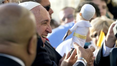 A Pope Francis doll amuses the man himself at John F. Kennedy International Airport.